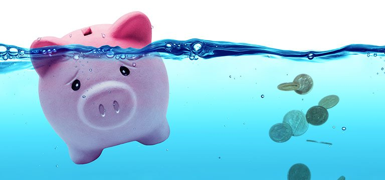 money and piggy bank in water